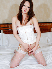 Newhalf porn-star posing in white stockings and corset