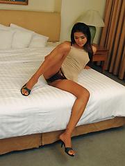 Sexy young Thai ladyboy empties her balls