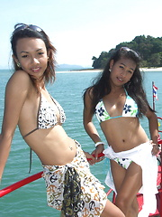 Three cute ladyboys guide us in a tropical cruise in the south of Thailand