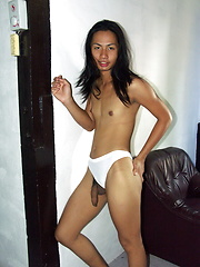 Cute shemale stripping and proudly exhibiting her hard dick