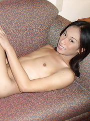 Slim Filipino shemale stripping and flashing her assets