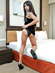 Ladyboy twists her nipples and jerks off
