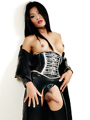 Ladyboy in latex shows off her hard cock
