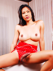 A Sexy Oriental Tranny in red lingerie with a raging hardon