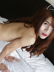 18 year old horny Thai ladyboy with big boobs does a striptease